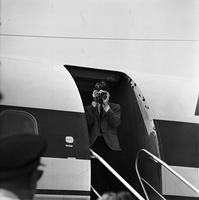 Beatles:  Ringo Starr and John Lennon board plane for Montreal