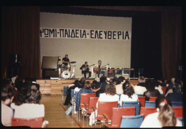 "Presentation for Polytechnic Institute – Banner reads ""Bread, Education, Freedom"" – Greek Community of Toronto"