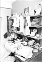 Image of Celia Franca working from her desk at home.