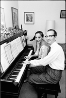 Image of Celia Franca and her husband, James Morton, at a piano in their home.