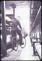 Bicycle rider in utility tunnel