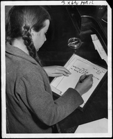 Ann Ryan writing a letter home