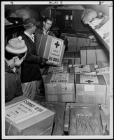 TCA workers load parcels into aircraft which will means so much to thousands of refugee children