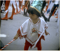 Toddler in costume participating in Caribana parade