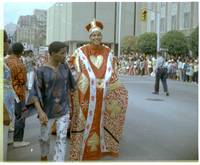 A young man in costume portraying the king from a deck of cards during the Caribana parade