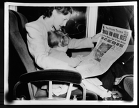 Woman reading The Evening Telegram