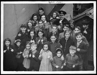 """After withstanding attacks from German airmen and U-boats, these happy-looking children are shown with thumbs up as they arrived recently at an eastern Canadian port. And if you think the ship's master wasn't a popular ""daddy"" to the youngsters..."