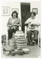 Two First Nations women basket weaving
