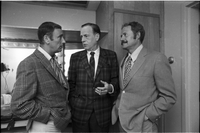 "Marshall McLuhan (centre), wearing jacket and tie of ""Maple Leaf"" tartan fabric designed by David Weiser, with Dick Martin (left) and Dan Rowan (right) of Rowan & Martin's Laugh-In (TV show)."