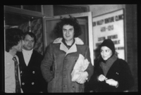 Mikis Theodorakis, Aphrodite Manou and George Papadatos outside the Trojan Horse Coffee House