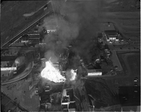 "Aerial view of the gas fire in progress at the ""Four Corners"" (the intersection of Airport and Derry Road) in Malton."