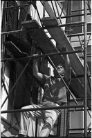 "Sculptor, Walter Yarwood, climbs up scaffolding outside Sidney Smith Hall, St. Geoerge Campus, University of Toronto; during the installation of his bronze ""Horizon"""