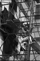 "Sculptor, Walter Yarwood, climbs down scaffolding outside Sidney Smith Hall, St. Geoerge Campus, University of Toronto; during the installation of his bronze ""Horizon"""