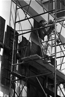 "Sculptor, Walter Yarwood, climbs on scaffolding outside Sidney Smith Hall, St. Geoerge Campus, University of Toronto; during the installation of his bronze ""Horizon"""