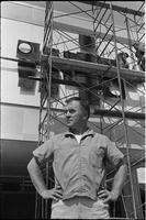 "Sculptor, Walter Yarwood, stands in front of scaffolding outside Sidney Smith Hall, St. Geoerge Campus, University of Toronto; during the installation of his bronze ""Horizon"""