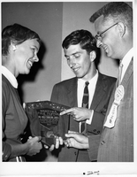 Portrait of Ruth Jones and Dr. Crawford Jones holding a brass plaque, 1961