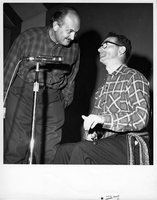 Jacques Labrecque and Jean Carignan performing on stage at the Mariposa Folk Festival, 1961