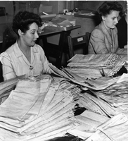 Tax sorter Mary Conners working at the Dominion Government Building on Front Street