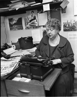 Journalist, Lillian Foster, typing at her desk in the Toronto Telegram Building.