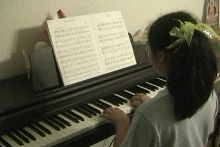 Long family videos : piano : girl with bow