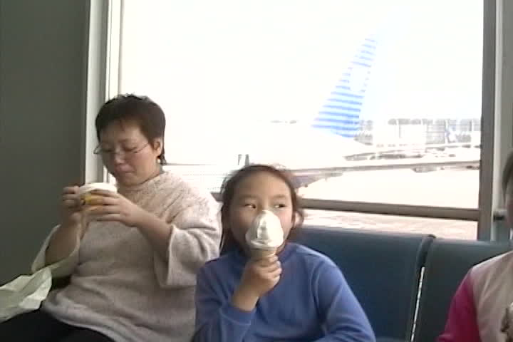Long family videos : airport waiting area : ice cream