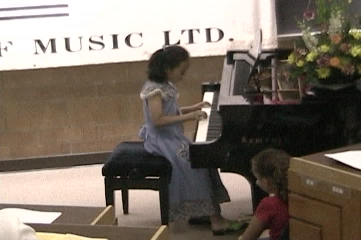 Long family videos : New  Conservatory of Music : playing the piano