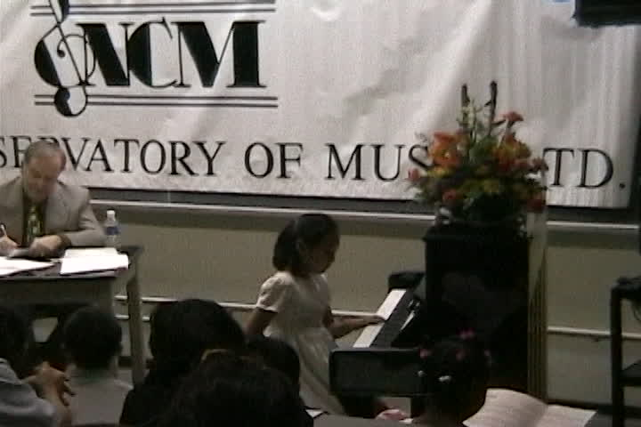 Long family videos : New  Conservatory of Music : man writing and child playing