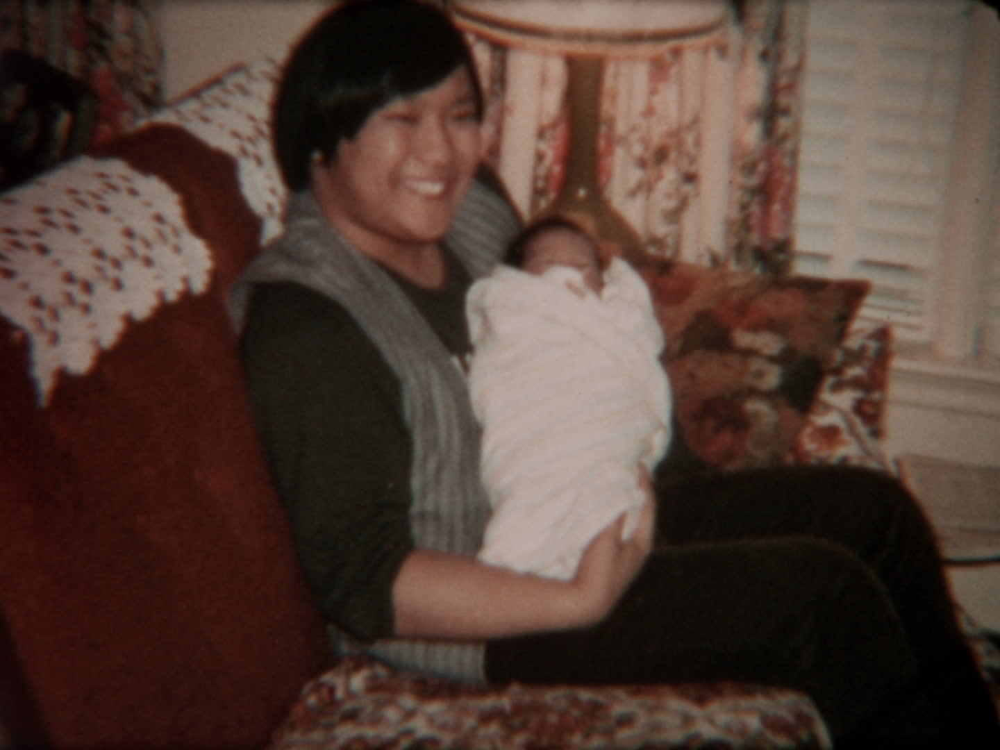 Watada family videos : woman holding a baby