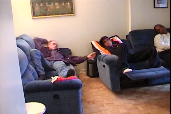 Dhoré family videos : holding a newborn and men sleeping on the couch