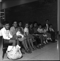 Giovanni Procopio, seated with his wife, and their 10 children, ages 18 months to 17 years, at the airport in Malton.