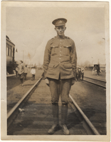 Photograph of  soldier at railroad