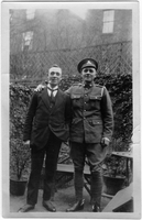 Photograph of two men in garden