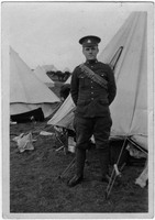 Photograph of  soldier [at camp] wearing bandolier