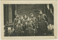 Photograph of soldiers in front of building