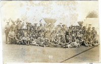 Photograph of soldiers at camp with flags