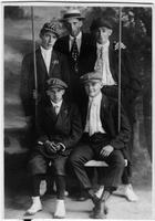 Portrait of five young men on swing