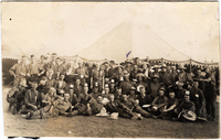 Photograph of soldiers at camp in relaxed pose