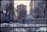 Fort Garry Gate in winter with buildings in the background