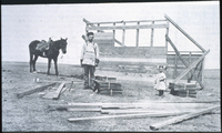 Guy McCumsey building his house in Munson, Alberta - 1913