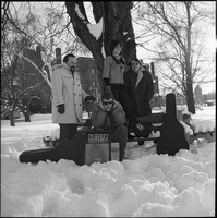 The Dirty Shames rock band standing next to a bench at winter time in Queen's Park.