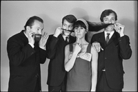 Image of the Dirty Shames rock band posing for a formal portrait with Amos Garrett and James McCarthy using Carol Robinson's hair as mustaches and Chick Roberts twirls his mustache.