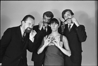 The Dirty Shames rock band posing for a formal portrait with Amos Garrett and James McCarthy using Carol Robinson's hair as mustaches and Chick Roberts twirls his mustache.