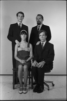 Image of the Dirty Shames rock band posing for a formal portrait with Carol Robinson and Amos Garrett seated in chairs.