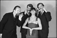 The Dirty Shames rock band posing for a formal portrait with Amos Garrett and James McCarthy using Carol Robinson's hair as mustaches and Chick Roberts twirling his mustache.