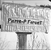 "Image of a mailbox on a post with ""Pierre-P Forget"" written on it."