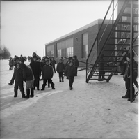 Image of a small group of children playing outside Sainte Croix elementary school in the winter in Lafontaine, Ontario.