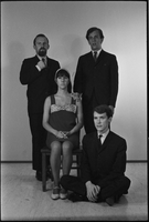 Image of the Dirty Shames rock band posing for a formal portrait with Carol Robinson seated on a chair, Jim McCarthy sitting on the floor and Chick Roberts and Amos Garrett standing behind them.