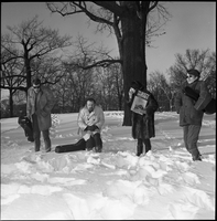The Dirty Shames rock band posing for a photo in the snow winter time in Queen's Park.
