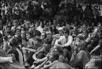 Image of a large crowd sitting and standing at a love-in in Queen's Park.