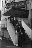 Image of City Muffin Boys on the steps of the Salvation Army Harbour Light Centre.